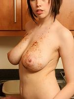 Busty brunette gets dirty with donuts